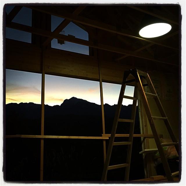 at the window 窓から見える甲斐駒ケ岳の夕景^^ 電気工事でホール部分のメインライトがつきました^^まだ窓はないけれど^^;