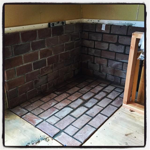 brick in 薪ストーブ用の炉台部分 レンガの施工が終了^^ モルタルで ラフに目地を入れてみたら それなりに良い雰囲気に仕上った^^ 乾くのを待って まわりに木を廻せば完成^^ #mountainmountain #nagasakabase #セルフビルド